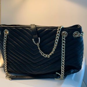 Black bag with gold chain straps